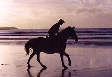 Riding on the beach.